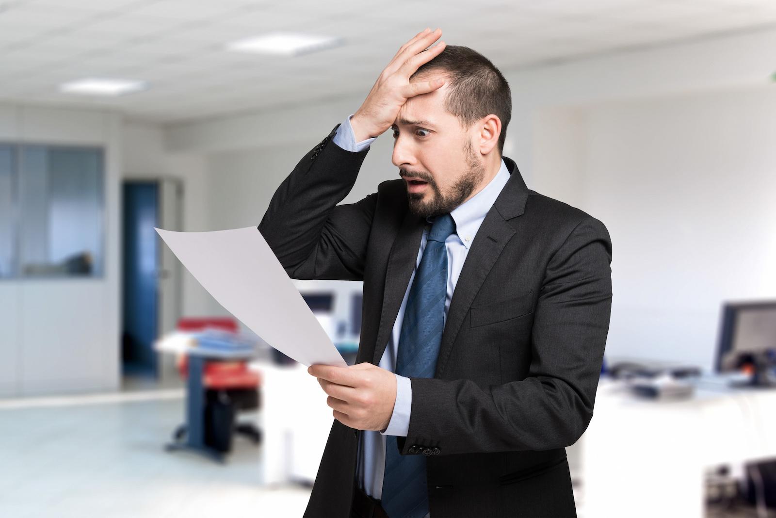 Desperate man reading a document