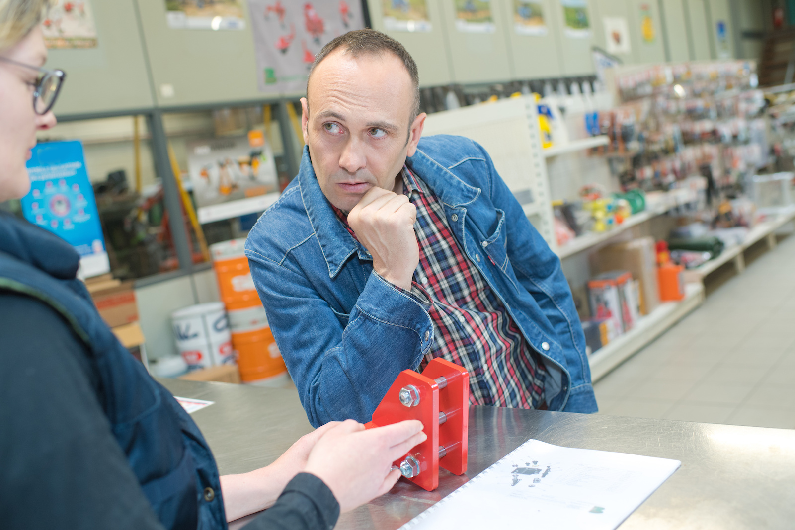 Shop assistant in conversation with skeptical customer