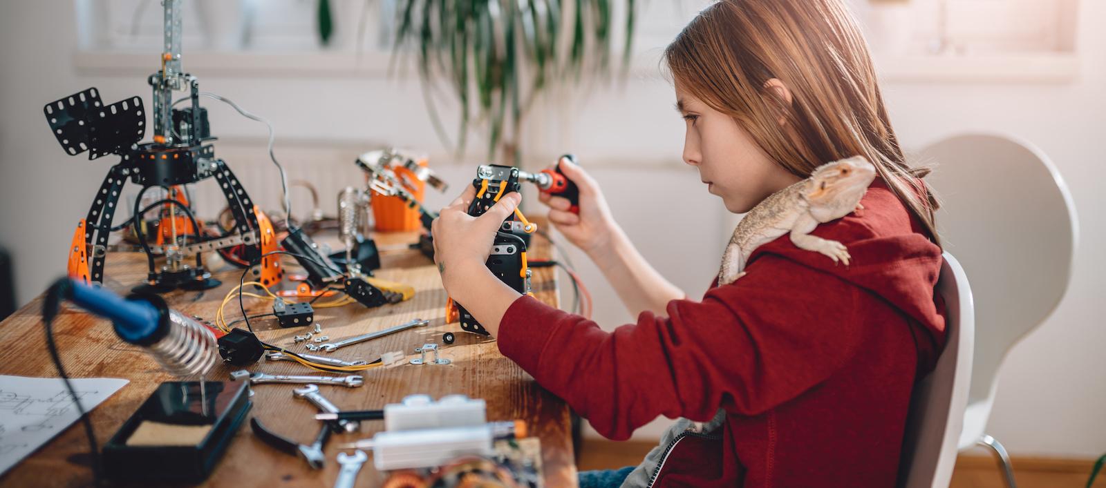 Girl building robot